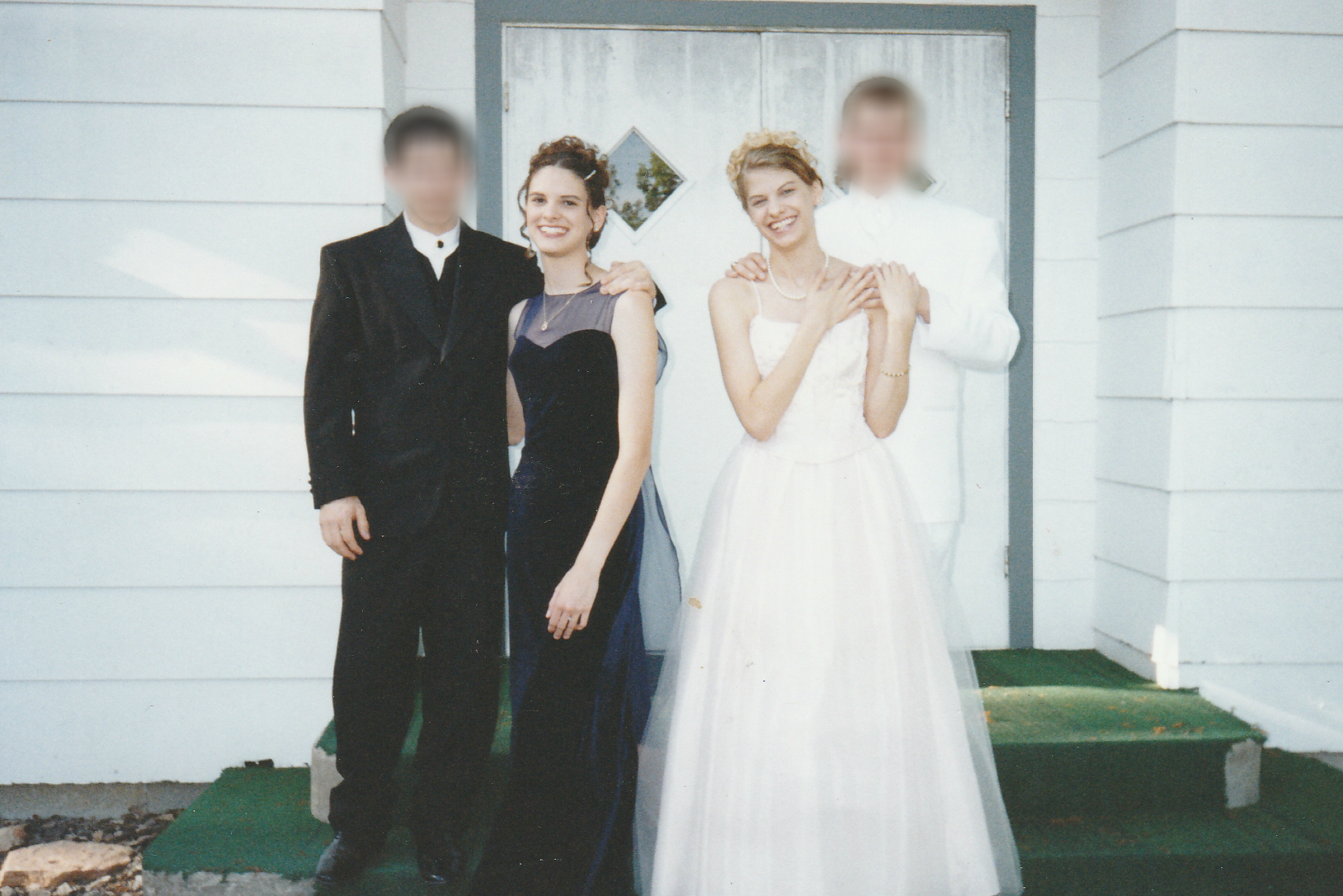 May 1999 - Posing for prom pictures on the church steps (the black mold in the background should have tipped us off something was afoot.)